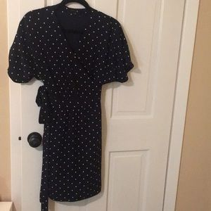 Polka dot navy blue and white wrap dress